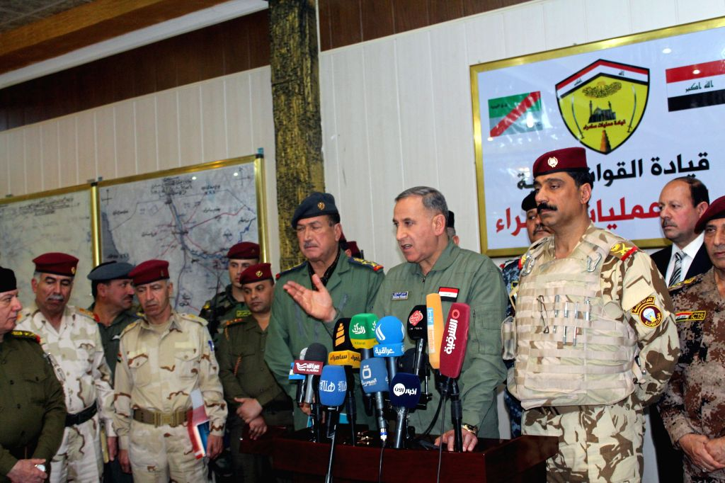 Iraqi Defense Minister Khalid al-Obeidi gives a speech at the military camps in Samarra, 120 km north of Baghdad, Iraq, to inspect the progress of the operations in ... - Khalid