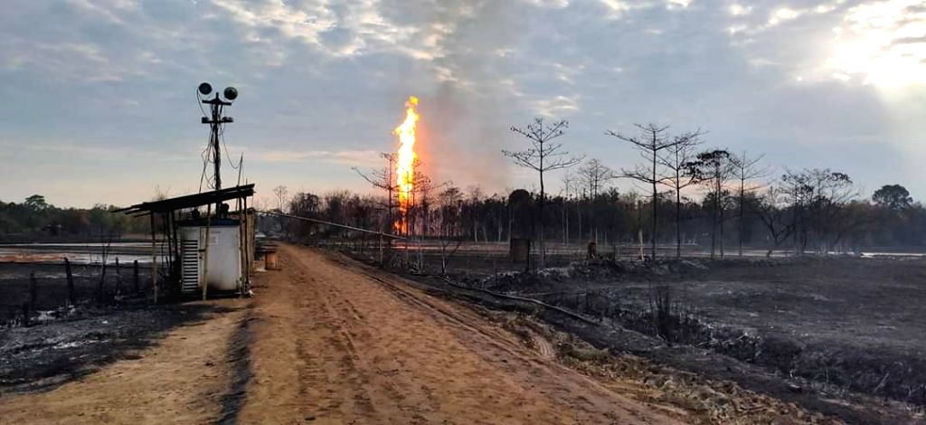 Tinsukia: Houses destroyed in a massive fire that broke out at the leaking natural gas producing well of Oil India Ltd (OIL) in Assam's Tinsukia district on June 10, 2020. (Photo: IANS)