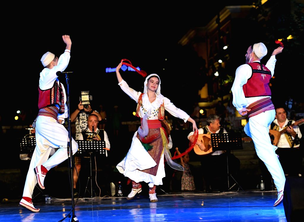 TIRANA, July 20, 2019 - Artists dance during a performance organized by the National Theater of Opera and Ballet of Albania and Tirana government in Tirana, Albania, July 19, 2019.