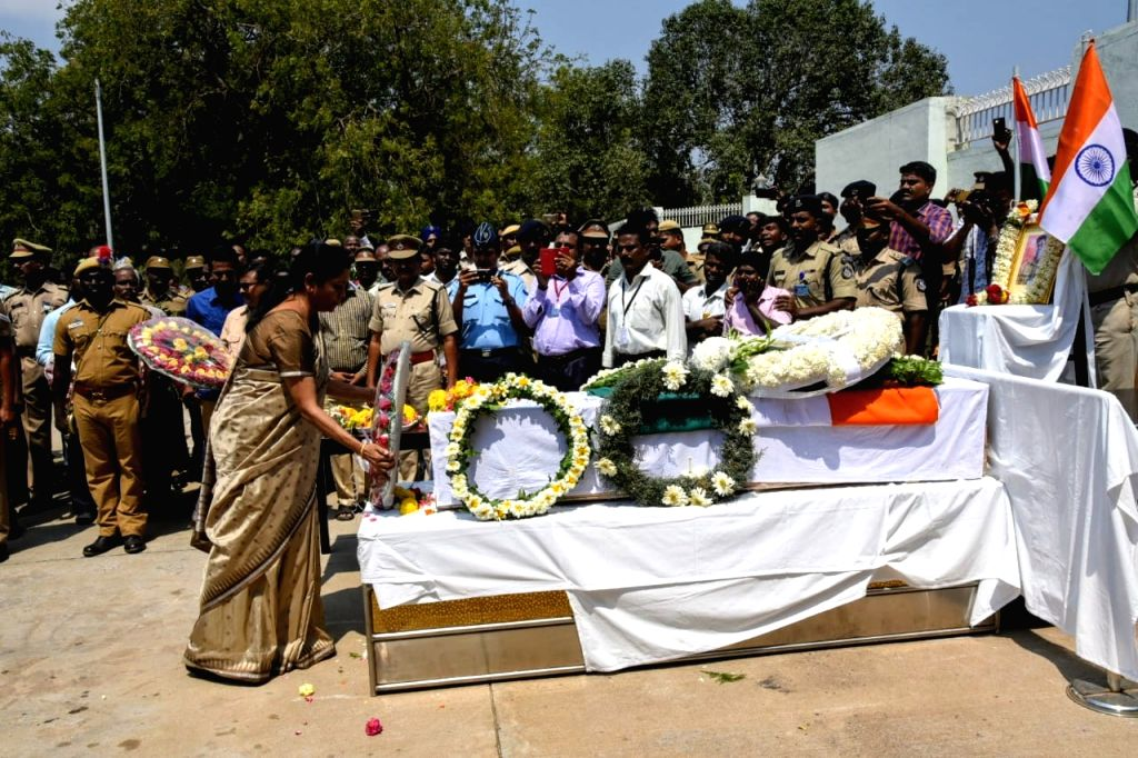 Tiruchirapalli: Defence Minister Nirmala Sitharaman lays wreath at the coffin of Sivchandran C, one of the 49 CRPF soldiers killed in 14 Feb Pulwama militant attacks at Tiruchirapalli in Tamil Nadu on Feb 16, 2019. (Photo: IANS) - Nirmala Sitharaman