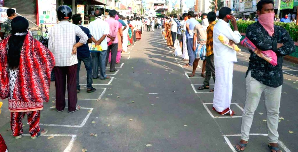 Tirupati: People practise social distancing as they queue up to buy essential commodities at a market in Tirupati, Andhra Pradesh on March 26, 2020. (Photo: IANS)