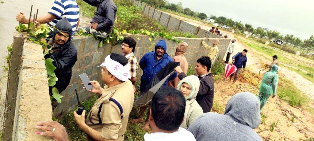 Tirupati police rescue two farmers stuck in floodwaters.