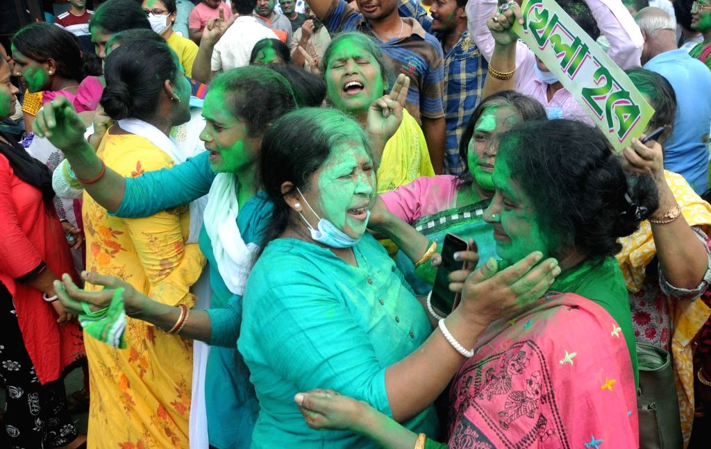 TMC activists celebrate after the Bhawanipur constituency by-poll result, near West Bengal Chief Minister Mamata Banerjee house in Kolkata on Sunday, October 03, 2021. - Mamata Banerjee