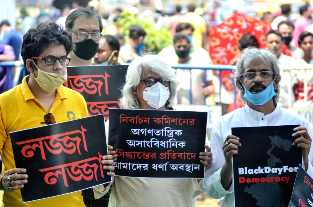 TMC activists protested against the Election Commission during the State Assembly Election in front of Gandhi Statue in Kolkata on April 13, 2021.