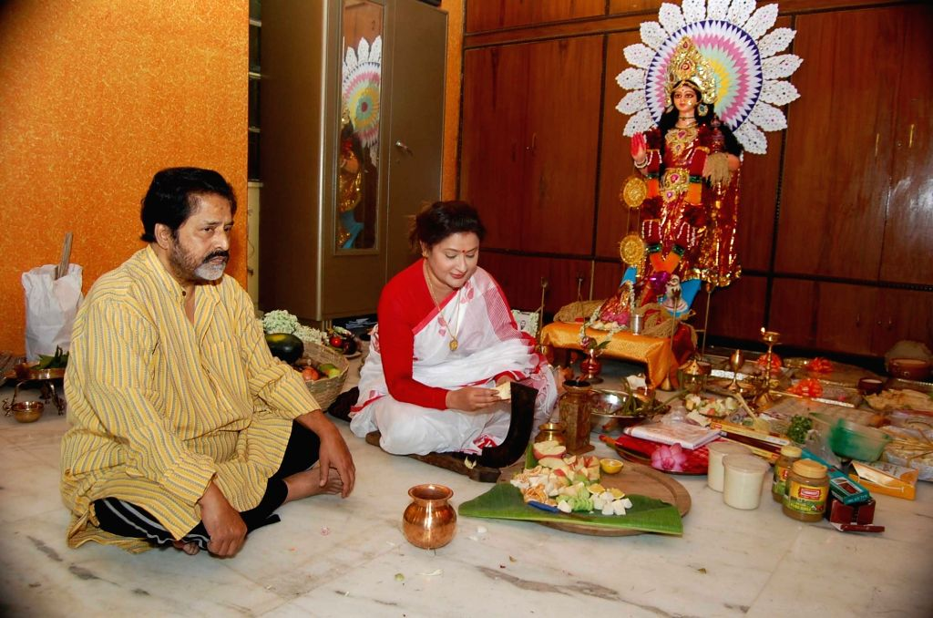 TMC leader Sudip Bandyopadhyay and MLA Nayna Bandyopadhyay perform Laxmi Puja at their residence in Kolkata on Oct 15, 2016.