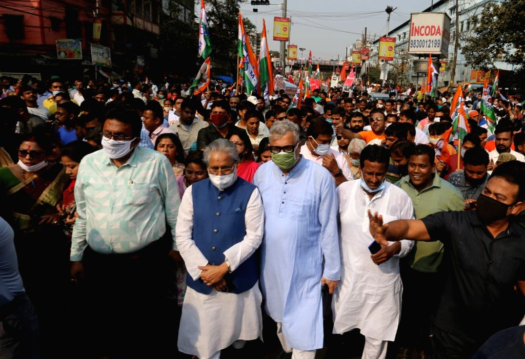 TMC leaders and activists took part in a protest rally against fuel price hike in Kolkata on Feb 21, 2021.