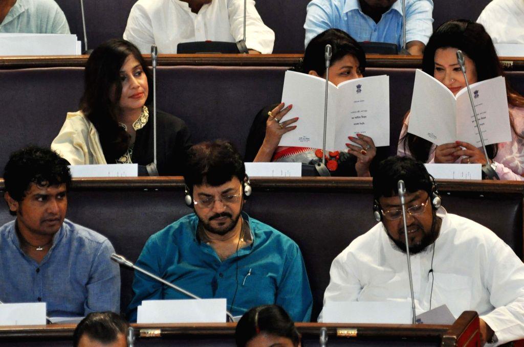 TMC legislators Vaishali Dalmiya, Debashree Roy, Nayana Banerjee, Chiranjeet Chakraborty, Dibyendu Biswas at the state assembly during budget session of the assembly in Kolkata on June 24, ... - Debashree Roy, Nayana Banerjee and Chiranjeet Chakraborty