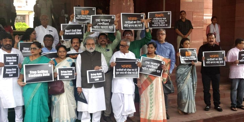 TMC MPs stage a demonstration demanding the government to urgently bring data protection law, at Parliament in New Delhi on July 16, 2019.