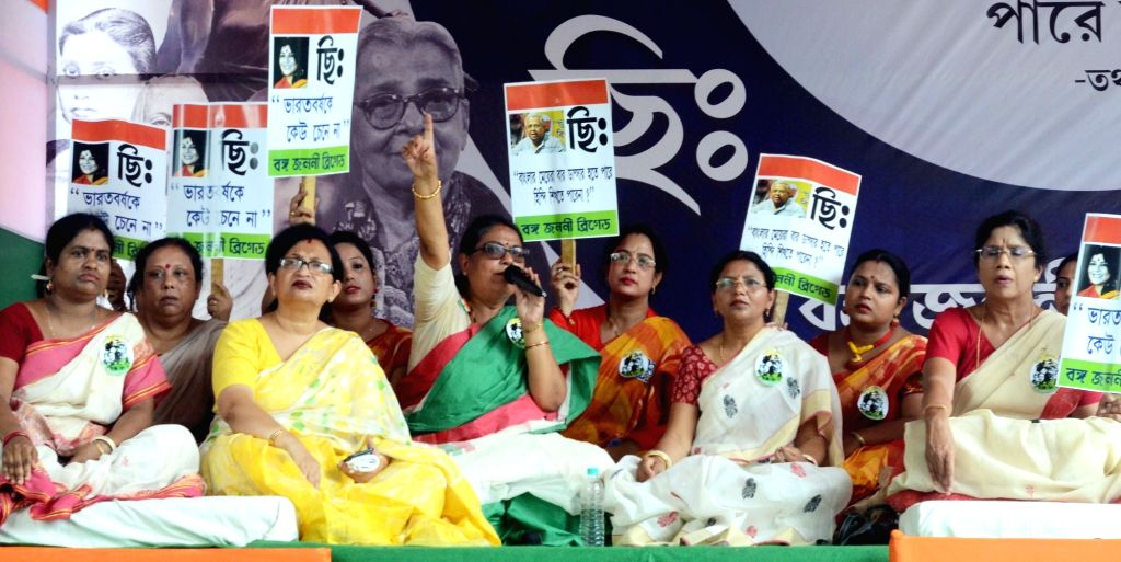 "TMC workers led by party leaders Kakoli Ghosh Dastidar, Chandrima Bhattacharya and West Bengal Minister Shashi Panja particiopate in ""Bango Janoni Sabha"" as they stage a ... - Shashi Panja and Kakoli Ghosh Dastidar"