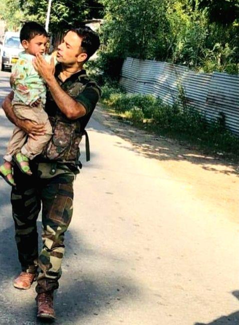 Toddler rescued after watching grandad die in Kashmir terror strike.