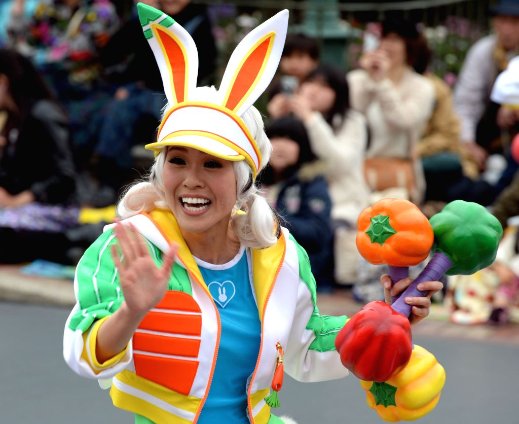Actors dressed as Disney characters perform on a float in a parade in Tokyo Disneyland in Tokyo, Japan, April 1, 2015.