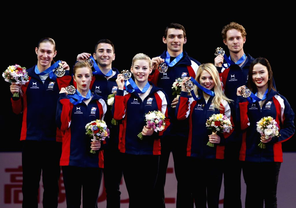 Ashley Wagner, Gracie Gold, Alexa Scimeca, Madison Chock (L-R, front), Jason Brown, Max Aaron, Chris Knierim, and Evan Bates (rear, L-R) pose for photographs during ...