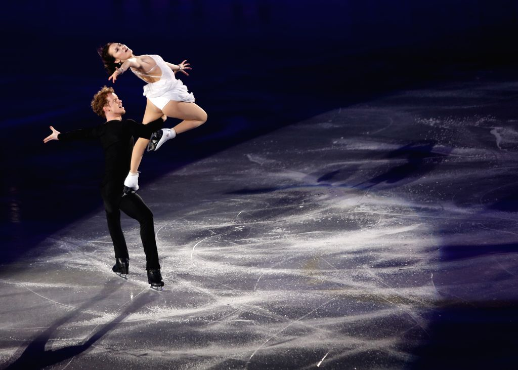 Madison Chock (R) and Evan Bates of the United States perform during the exhibition at the International Skating Union (ISU) World Team Trophy of Figure Skating 2015 ...