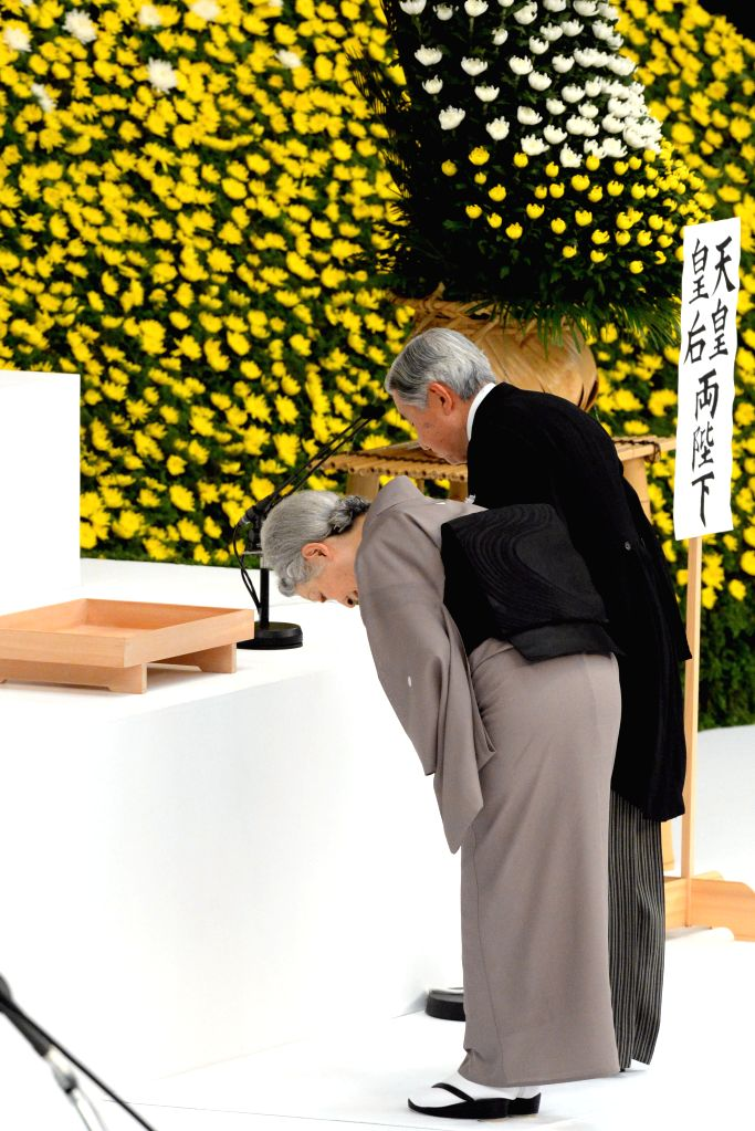 Japanese Emperor Akihito and Empress Michiko attend an annual memorial service for Japan's war dead in Tokyo on Aug. 15, 2014, on the 69th anniversary of Japan's ...
