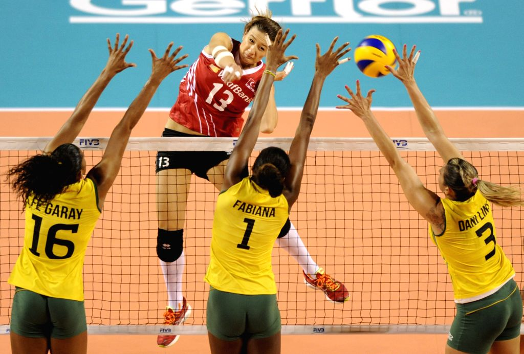 Neriman Ozsoy (2nd L) of Turkey spikes the ball during the Final Round match of FIVB Women's Volleyball World Grand Prix 2014 against Brazil in Tokyo, Japan, Aug. 20,