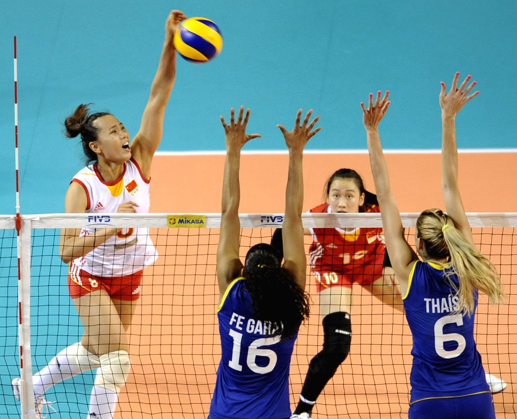 Zeng Chunlei of China spikes the ball during the Final Round match of FIVB Women's Volleyball World Grand Prix 2014 against Brazil in Tokyo, Japan, Aug. 21, 2014. ...