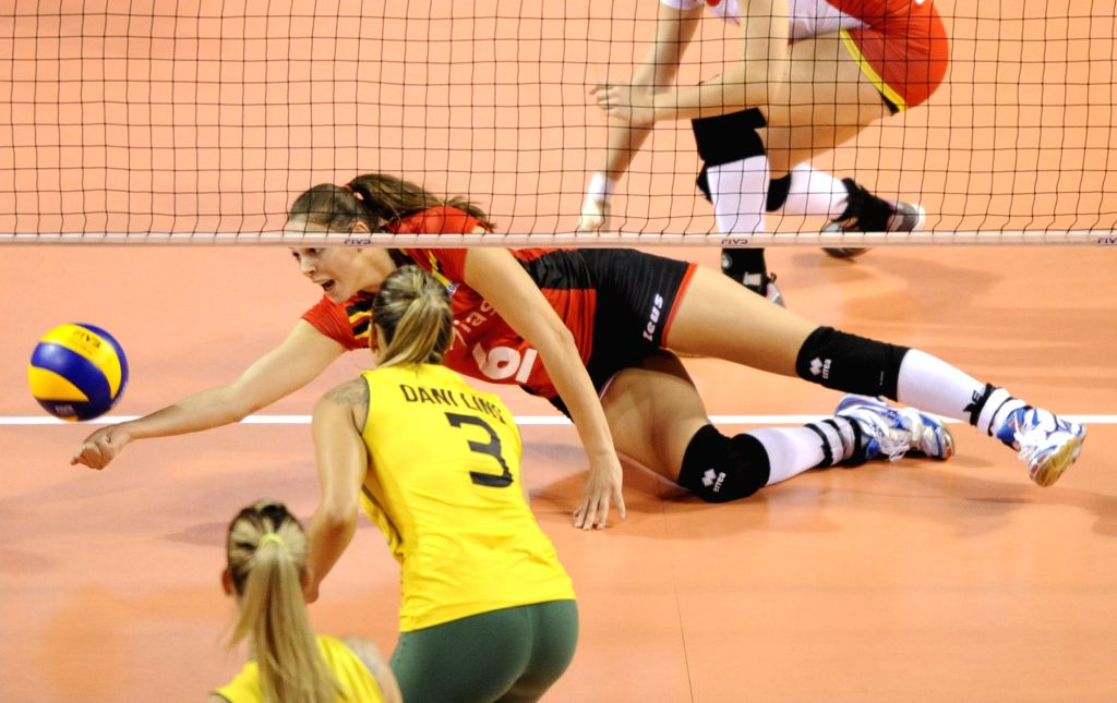 Leys Charlotte of Belgium fails to save the ball during the final round match against Brazil in FIVB Women's Volleyball World Grand Prix in Tokyo, Japan, Aug. 22, ...