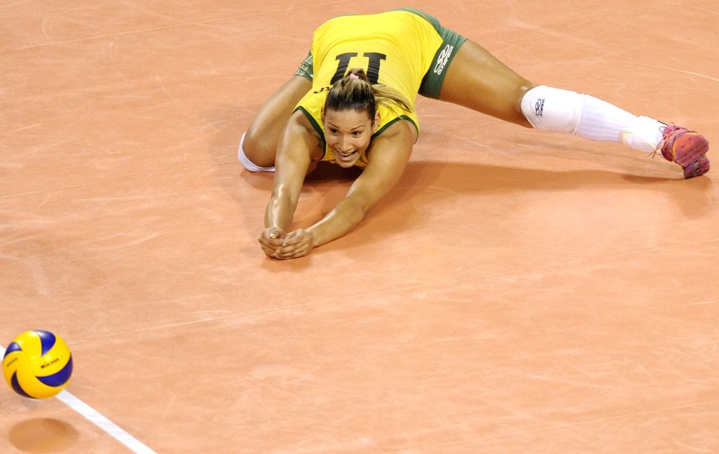 Tandara Caizeta of Brazil fails to save the ball during the final round match against Belgium in FIVB Women's Volleyball World Grand Prix in Tokyo, Japan, Aug. 22, ...