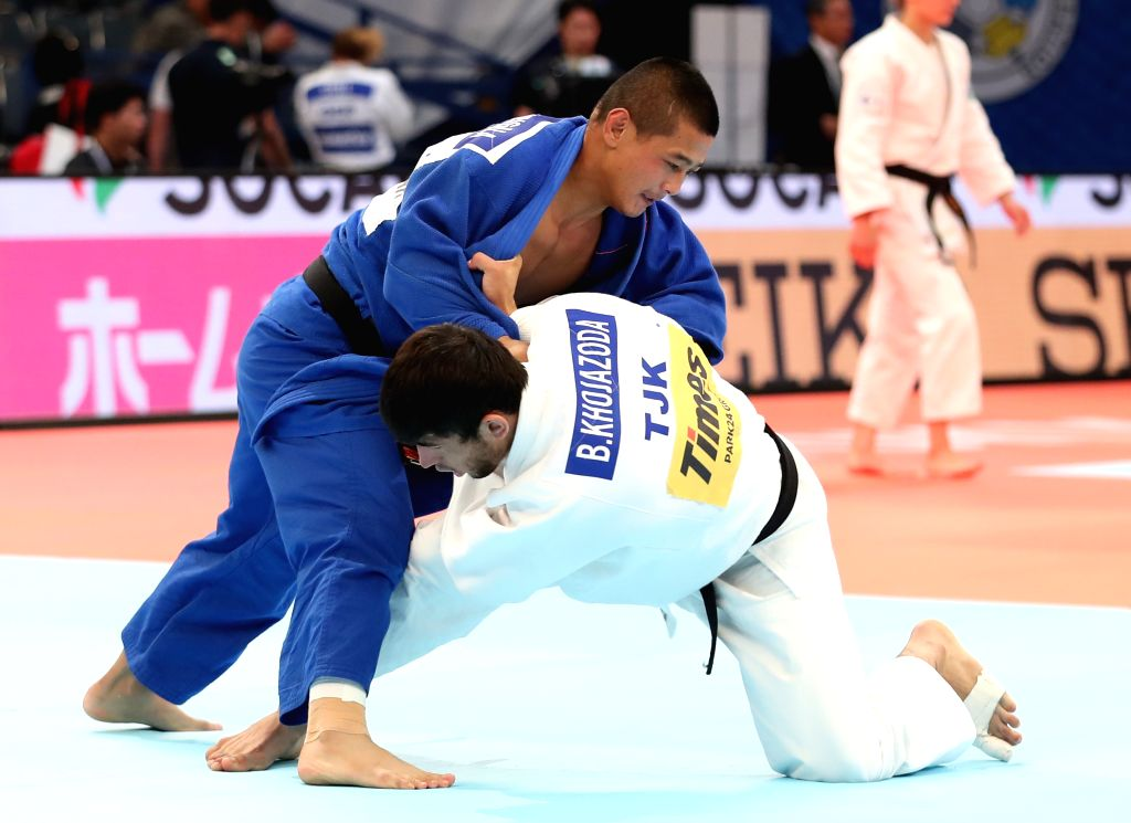 TOKYO, Aug. 27, 2019 - Saiyinjirigala (L) of China and Behruzi Khojazoda of Tajikistan during the the 4th round match of men's 73 kg category at the 2019 World Judo Championships in Tokyo, Japan on ...