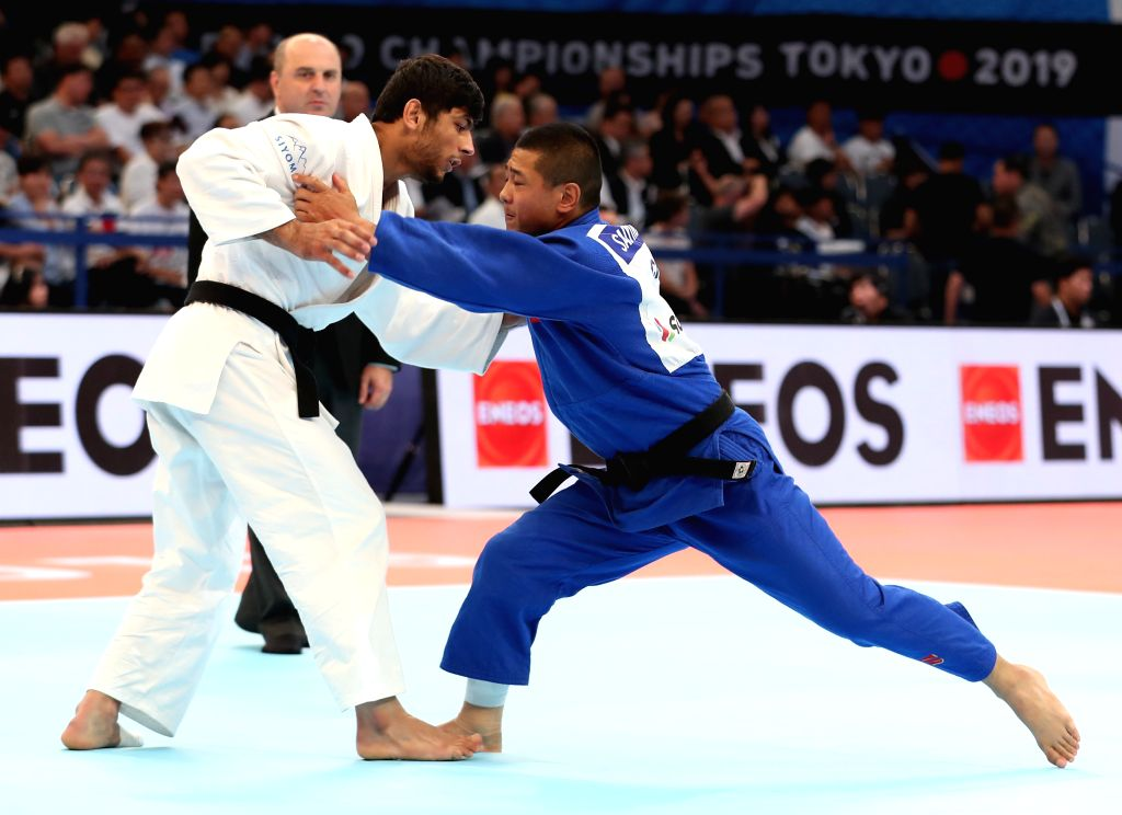 TOKYO, Aug. 27, 2019 - Saiyinjirigala (R) of China and Behruzi Khojazoda of Tajikistan during the the 4th round match of men's 73 kg category at the 2019 World Judo Championships in Tokyo, Japan on ...