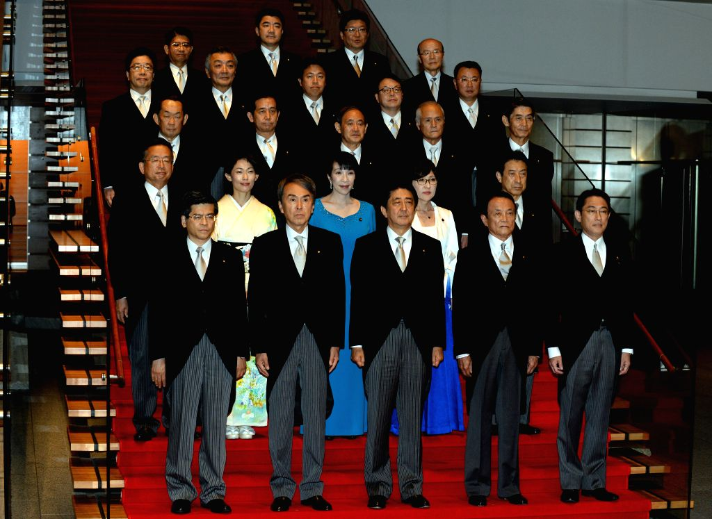 TOKYO, Aug. 3, 2016 - Japanese Prime Minister Shinzo Abe (C, Front) and cabinet ministers pose during a photo session at Abe's official residence in Tokyo, capital of Japan, on Aug. 3, 2016. Japanese ... - Shinzo Abe