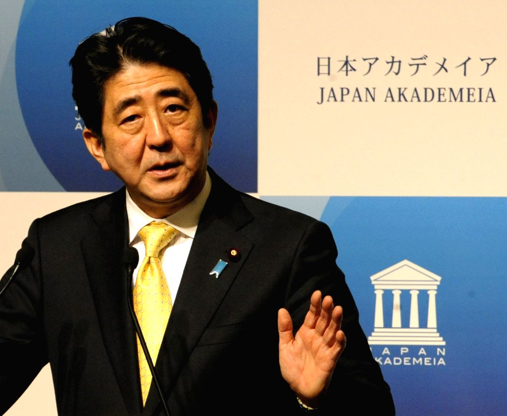 Japanese Prime Minister Shinzo Abe speaks during a meeting of Japan Akademeia in Tokyo, capital of Japan, on Dec. 19, 2013.