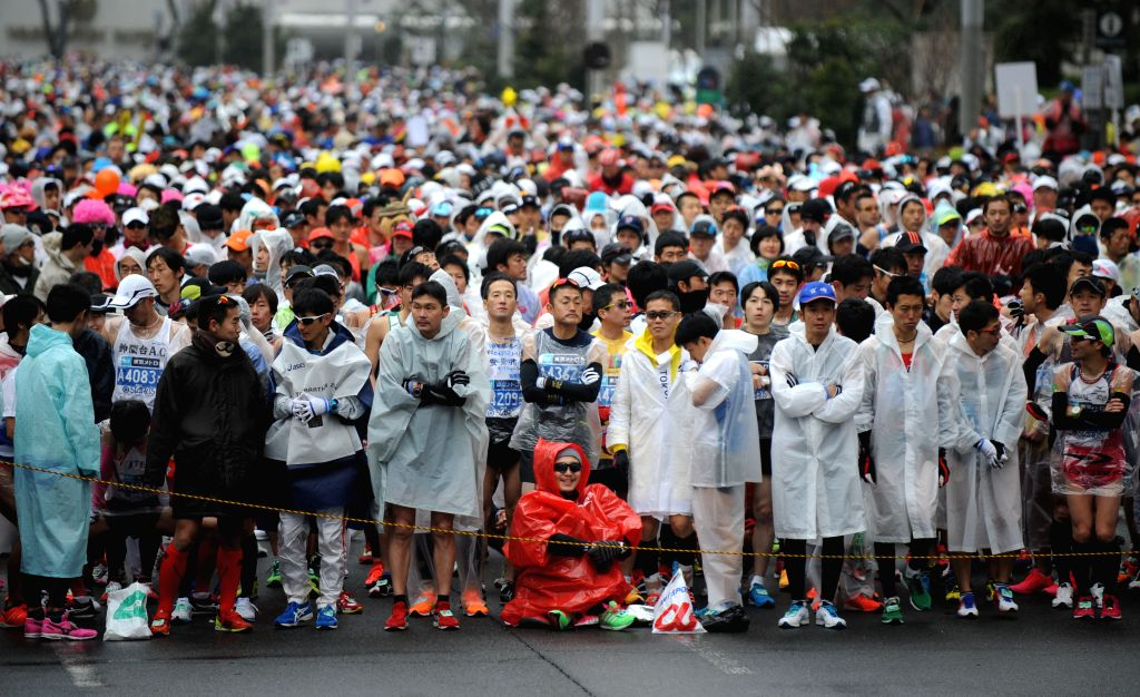 Marathon runners wait for the start at the Tokyo metropolitan government building during the Tokyo Marathon 2015 in Tokyo, Japan, Feb. 22, 2015. About 36,000 people ...