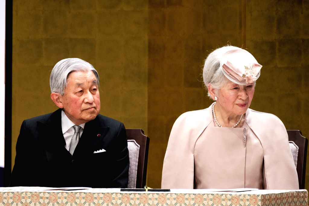 TOKYO, Feb. 24, 2019 - Japanese Emperor Akihito (L) and Empress Michiko attend the ceremony to mark the 30th anniversary of emperor's enthronement in Tokyo, Japan, Feb. 24, 2019.