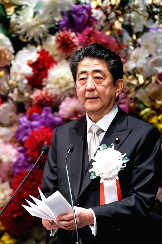 TOKYO, Feb. 24, 2019 - Japanese Prime Minister Shinzo Abe attends the ceremony to mark the 30th anniversary of emperor's enthronement at the National Theater in Tokyo, Japan, Feb. 24, 2019. - Shinzo Abe