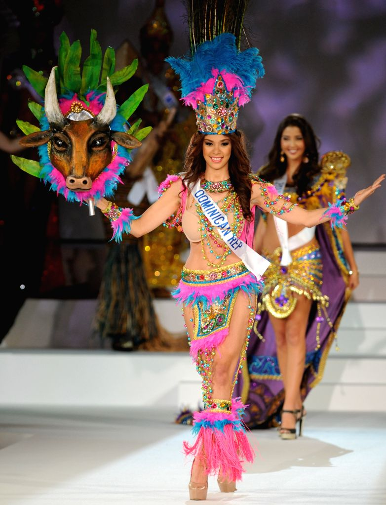Tokyo (Japan): Miss Dominican Republic Barbara Santana (front) walks during the Miss International Beauty Pageant 2014 in Tokyo, Japan, Nov. 11, 2014. 74 Contestants took part in the annual beauty ...