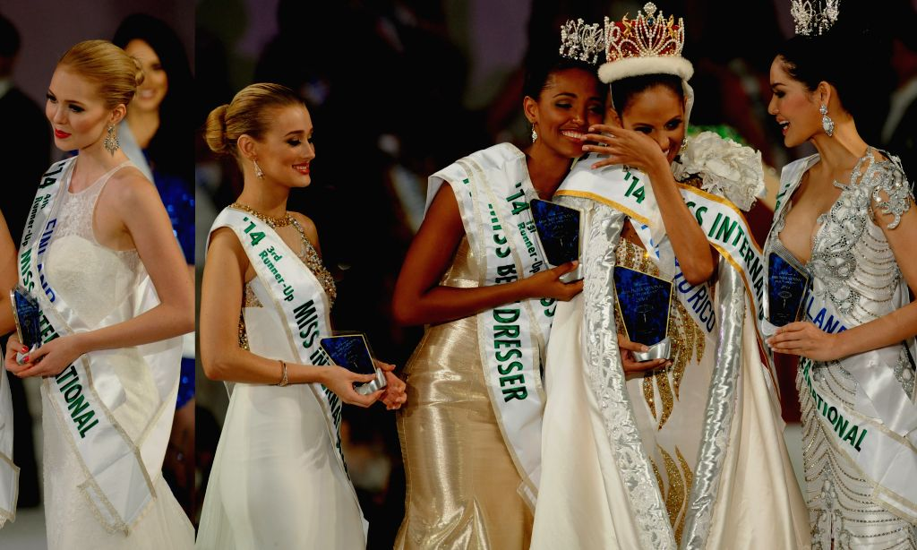 Tokyo (Japan): Miss Puerto Rico Valerie Hernandez (C), Miss Colombia Zuleika Suarez (2nd L), Miss  Thailand Punika Kulsoontornrut (2nd R), Miss United Kingdom Victoria Tooby (L) and Miss Finland ...