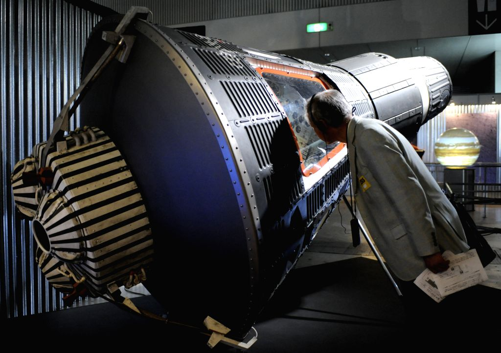 "A man looks at a replica of the Mercury Spacecraft during a press preview of ""SPACE EXPO 2014"" at Makuhari Messe in Chiba prefecture, east of Tokyo, Japan, ."