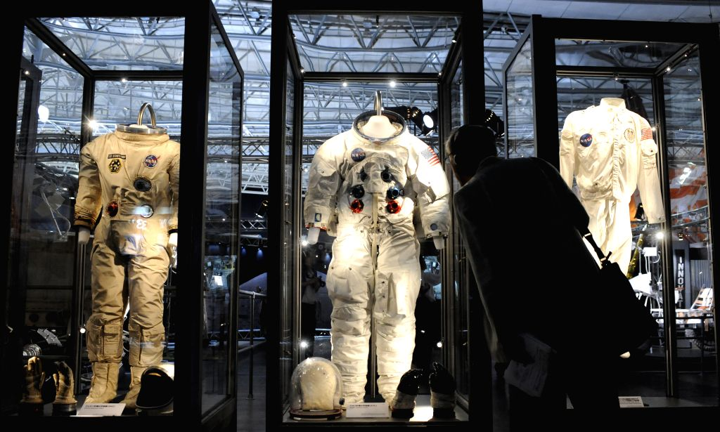 "A man looks at the space suits during a press preview of ""SPACE EXPO 2014"" at Makuhari Messe in Chiba prefecture, east of Tokyo, Japan, July 18, 2014. The .."
