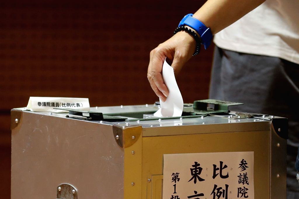 TOKYO, July 21, 2019 (Xinhua) -- A voter casts the ballot at a polling station in Tokyo, Japan, July 21, 2019. Voters across Japan began casting their ballots on Sunday in the upper house election, which is expected to be a barometer of public opinio - Shinzo A