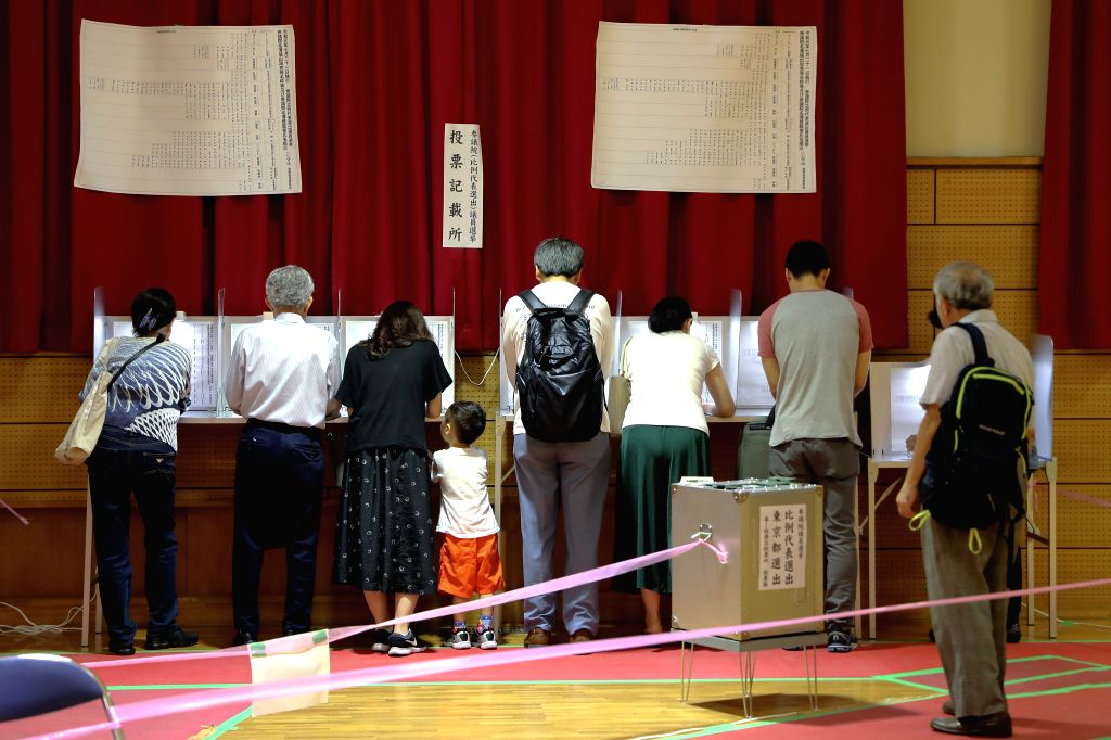 TOKYO, July 21, 2019 (Xinhua) -- Voters fill out their ballots at a polling station in Tokyo, Japan, July 21, 2019. Voters across Japan began casting their ballots on Sunday in the upper house election, which is expected to be a barometer of public o - Shinzo A