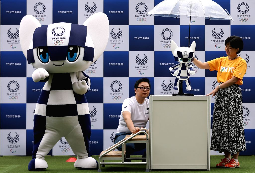 TOKYO, July 22, 2019 - Mascot Miraitowa (1st L) makes the same pose with mascot robot Miraitowa during the Tokyo 2020 mascot robots unveiling event in Tokyo, Japan, on July 22, 2019. Tokyo 2020 ...