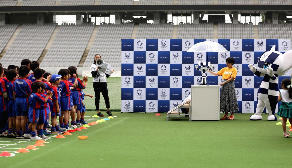 TOKYO, July 22, 2019 - Mascot robot Miraitowa waves to the children during the Tokyo 2020 mascot robots unveiling event in Tokyo, Japan, on July 22, 2019. Tokyo 2020 Mascot-type robots will welcome ...