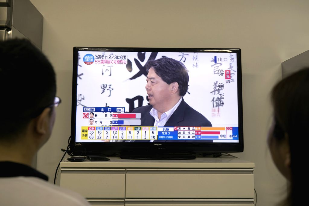 TOKYO, July 22, 2019 - People watch the TV program of the upper house election in Tokyo, Japan, on July 21, 2019. Japan's ruling bloc led by Prime Minister Shinzo Abe won more than half of the ... - Shinzo Abe