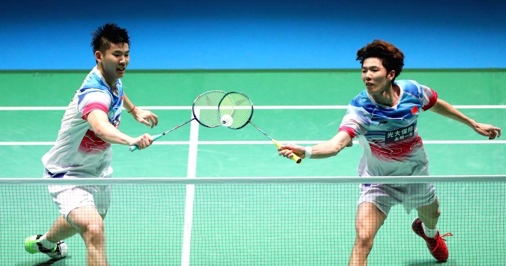 TOKYO, July 26, 2019 - Li Junhui (R)/Liu Yuchen of China compete during the men's doubles quarterfinals against Hiroyuki Endo/Yuta Watanabe of Japan at Japan Open 2019 badminton tournament in Tokyo, ...