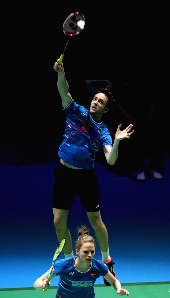 TOKYO, July 26, 2019 - Mark Lamsfuss(top)/Isabel Herttrich of Germany competes during the mixed doubles quarterfinals between Wang Yilyu/Huang Dongping of China and Mark Lamsfuss/Isabel Herttrich of ...
