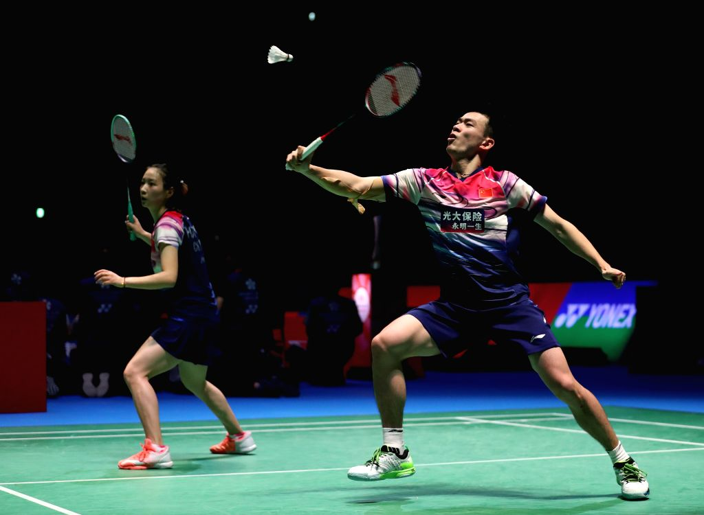 TOKYO, July 26, 2019 - Zheng Siwei (R)/Huang Yaqiong of China compete during the mixed doubles quarterfinals against Hafiz Faizal/Gloria Emanuelle Widjaja of Indonesia at Japan Open 2019 badminton ...