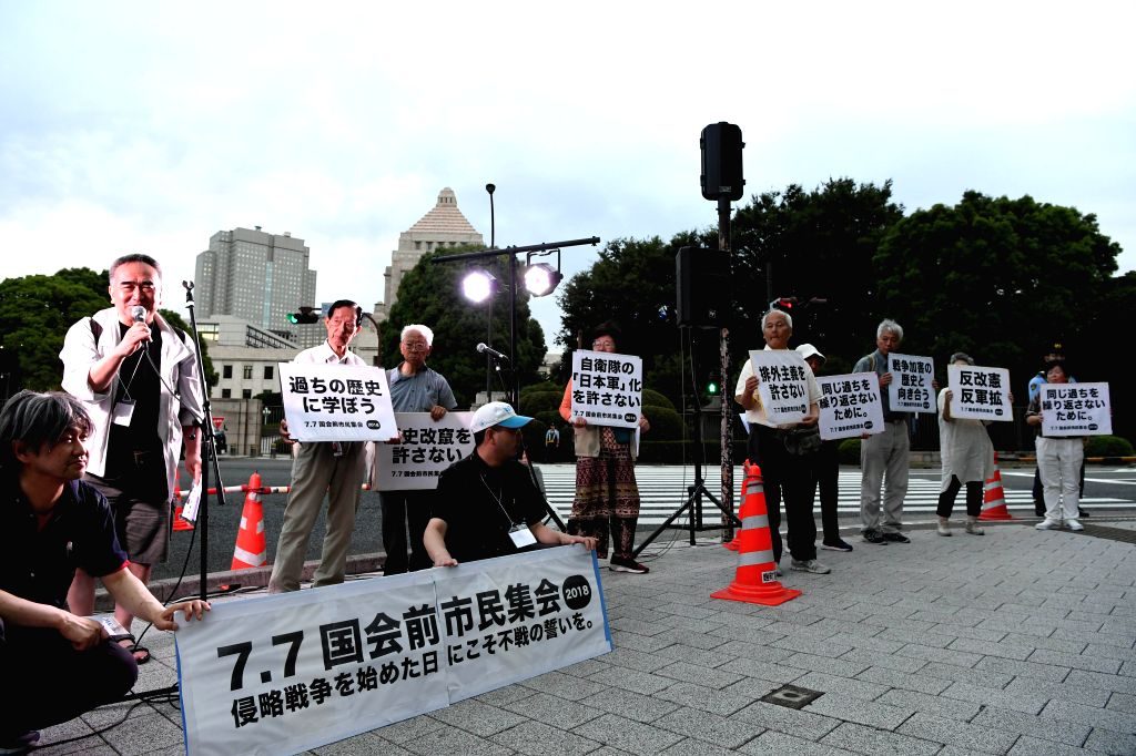 TOKYO, July 7, 2018 - Japanese civil groups rally in front of the House of Councilors building in Tokyo, Japan, July 7, 2018. Japanese civil groups called upon the nation to learn from the history ...