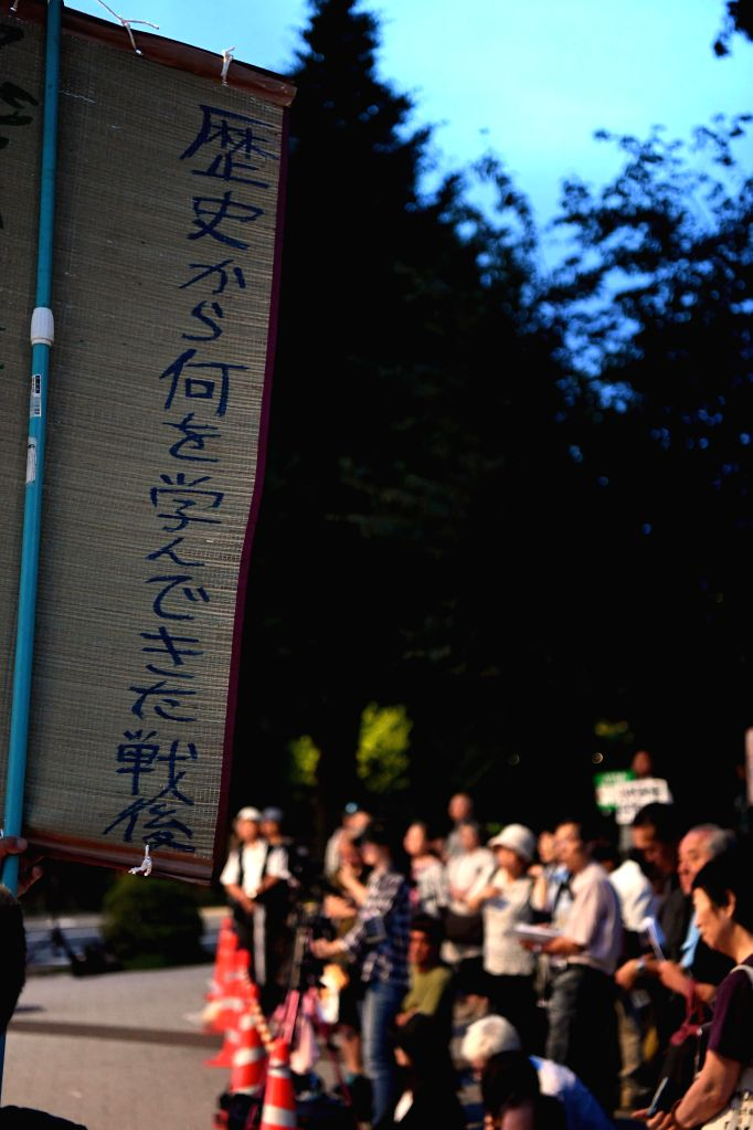 TOKYO, July 7, 2018 - Members of Japanese civil groups attend a rally in front of the House of Councilors building in Tokyo, Japan, July 7, 2018. Japanese civil groups called upon the nation to learn ...