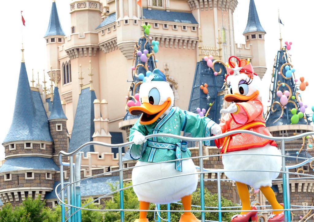 ":TOKYO, June 24, 2013 (Xinhua/IANS)Cartoon characters wave to tourists during a celebration march marking ""Tanabata"", or the Star Festival, at the Tokyo Disneyland in Urayasu, suburban Tokyo, ..."