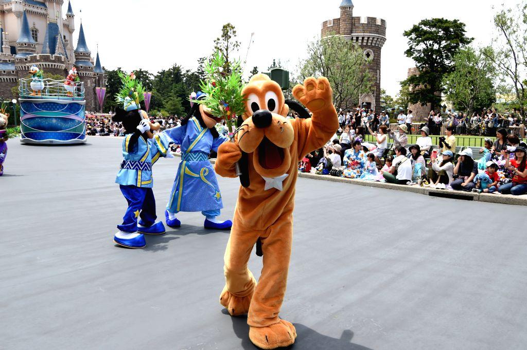 "TOKYO, June 7, 2018 - Actors dressed as cartoon characters participate in the parade celebrating ""Tanabata"", or the Star Festival, at the Tokyo Disneyland in Urayasu, suburban Tokyo, Japan, ..."