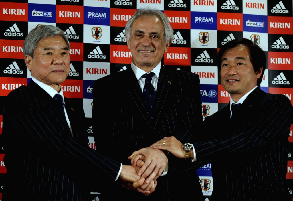 Japan's new national soccer team coach Vahid Halihodzic (C), President of Japan Football Association (JFA) Kuniya Daini (L) and JFA techinacal director Masahiro ...