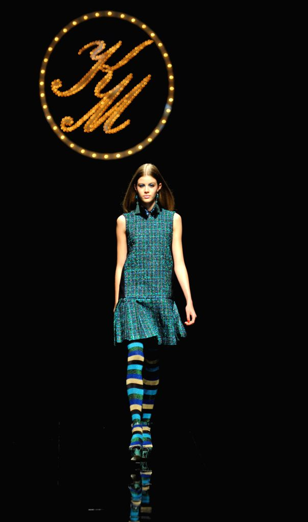 A model displays a creation designed by Keita Maruyama during his 2015-16 Autumn/Winter Collection at a fashion week in Tokyo, Japan, March 16, 2015. ...