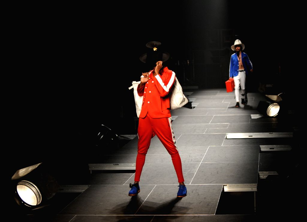 Models display creations designed by Takeo Kikuchi during 2015-16 Autumn/Winter Collection at a fashion week in Tokyo, Japan, March 16, 2015.
