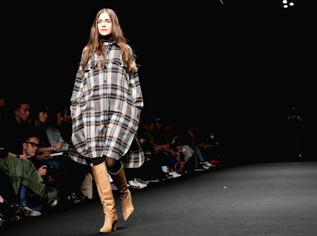 A model displays a creaction by designer Hidenori Kumakiri during the Autumn/Winter collection at Fashion Week in Tokyo, Japan, March 17, 2015.
