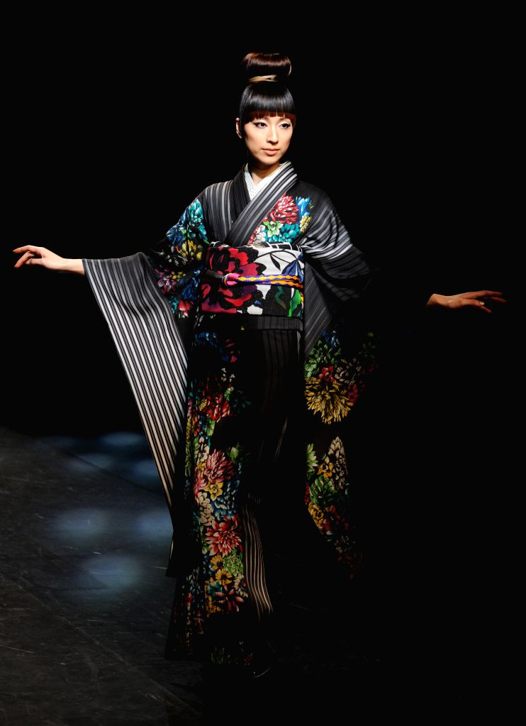A model displays a creation designed by Jotaro Saito during the Tokyo Fashion Week 2015 Autumn/Winter collection in Tokyo, Japan, March 19, 2015. ...